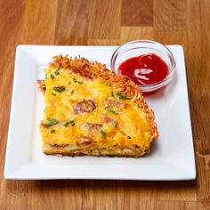 Servings: 4-6INGREDIENTS1 pound hash browns1 teaspoon salt1 teaspoon black pepper1 teaspoon paprika1 tablespoon vegetable oil6 eggs⅓ cup heavy cream or whole milk6 slices bacon1 cup cheddar cheese1 tablespoon fresh chives, choppedServe with ketchup or hot sauce (optional)PREPARATION1. Preheat oven to 350˚F/175˚C.2. In a medium bowl, season hash browns with salt, pepper, and paprika. Toss until fully incorporated.3. In a medium skillet, cook six slices of bacon until crispy. Set bacon aside…