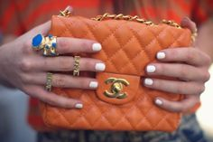 First of all: YSL lapis ring of my dreams. Second: orange Chanel bags seem like the height of delicious frivolity.