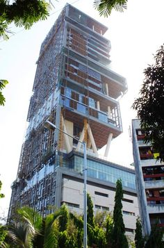 Antilia, the $2bn, 27-story home in poverty stricken India. Includes 3 rooftop helipads, and can accommodate 168 cars in the estate's parking garage.