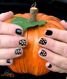 Candy Corn Cuteness | BeingGenevieve.com   This candy corn nail art is just too cute! The bright colors on the black nail polish are perfect for a Halloween manicure.