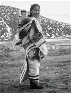 Inuit woman and baby. In many Arctic regions, a pouch is sewn onto the back of a woman's parka to hold her child. Furs made from walrus gut Kamleika, and the animals are essential to humans survival. Native American Photos, Native American Tribes, Native American History, Arte Inuit, Inuit Art, We Are The World, People Of The World, Native Indian, Native Art