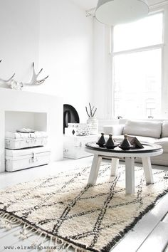 white living room black and white rug