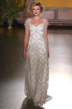 The pale gold and silver Guipure scallop motif lends an Art Deco or perhaps a regal feeling to the HELENE wedding gown.…