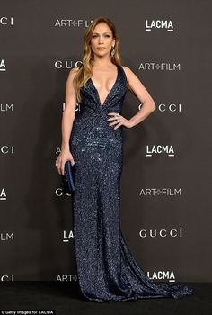 Jennifer Lopez heats up the red carpet in VERY plunging gown at Los Angeles film gala | Daily Mail Online