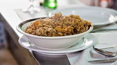 chicken stewed in its own blood with rice at Tasca do João restaurant : Bizarre Foods : TravelChannel.com