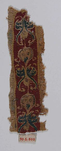 Fragment of Shoulder Band Object Name: Fragment Date: 6th–7th century Geography: Egypt Culture: Coptic Medium: Wool, linen; tapestry weave Dimensions: 5 7/8 in. high 1 9/16 in. wide (15 cm high 4 cm wide) Classification: Textiles