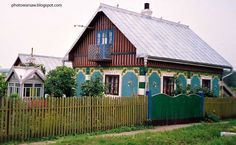 Beautiful Ukrainian cottage. The picture is a bit flurry because I've shot it from driving car. Howefer I put it here, because the house is just lovely.