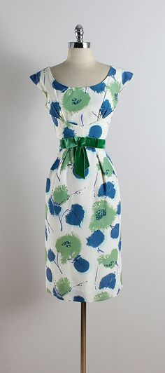 ➳ vintage 1950s dress * white nylon blend * blue & green floral print * acetate lining * green velvet bow accent * metal back zipper condition | excellent fits like medium length 42 bodice 16 bust 37 waist 29 hips 40 hem allowance 2.25 ➳ shop http://www.etsy.com/shop/millstreetvintage?ref=si_shop ➳ shop policies http://www.etsy.com/shop/millstreetvintage/policy twitter | MillStVintage facebook | millstreetvintage instagram | millstreetvintage 5763/1622