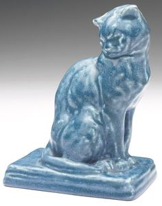 Rookwood seated cat figurine under a blue matte glaze, 1927 Sculptures, Lion Sculpture, Rookwood Pottery, Clay Paint, Cat Boarding, Porcelain Ceramics, Cat Art, Shades Of Blue, Painted Rocks