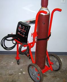 Welding Cart by dragginbalz -- Homemade welding cart fabricated from round tubing, angle iron, and steel plate. Intended to support a Hobart HH187 MIG welder and gas bottle. Wheeled cart is also partially caster-mounted for enhanced mobility. http://www.homemadetools.net/homemade-welding-cart-14