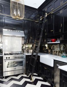 "The New Black - ""I saw it in a magazine years ago, and it was one of those images I just couldn't get out of my mind,"" says Wight of her glossy black kitchen. Here, Designers David Nastasi and Kate Vail combined dark cabinetry with chevron-patterned cork flooring and a gilded birdcage chandelier from Chameleon Fine Lighting for an elevated look that's at once old New York and contemporary chic."