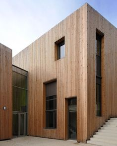 How do you feel about these exterior timber features ~ is it too much?  Residential Project by Rue Royale Architectes
