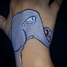 Sad crying elephant! Hand painting by Gennie Goose! Face painting painter paint. #wolfefx #fab #tag