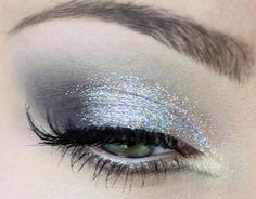 Silver eye makeup, glitter shadow and false lashes.