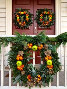 Colonial Christmas Wreath - Williamsburg, Virginia.  The Grand Illumination is always a fun weekend, the first weekend in December. Great way to kick off the Holiday season.  Decorations on the homes are fabulous!