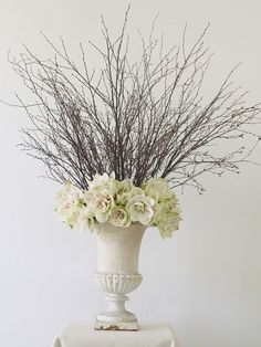 Over-the-Top Urn - At five feet tall, its grand scale is too much for a reception table, but it's perfect somewhere where it will get noticed, like an entrance hall or a buffet.