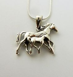 Sterling silver Horse and Foal Colt pendant on by celtictreasures