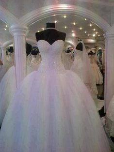 Beautiful tulle wedding dress. I love the top of this dress.