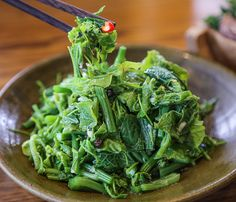 The startlingly green loofah sprout salad (RMB38) with mujiangzi – a type of dogwood plant found in Yunnan – is lightly blanched and still thrillingly crisp. | In & Out Yunnan Restaurant in Shanghai  Xintiandi