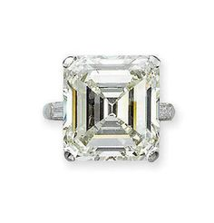 A DIAMOND RING, MOUNTED BY CARTIER   The rectangular-cut diamond weighing 17.51 carats to the baguette-cut diamond shoulders and plain hoop, mounted in platinum