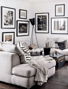 Black, White, and Gray Living Room with Throw Pillows and Gallery Wall of Art.