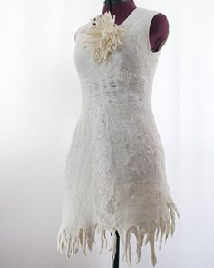 I always wanted to knit my own wedding dress. imagine it with felting, needlework and beadwork
