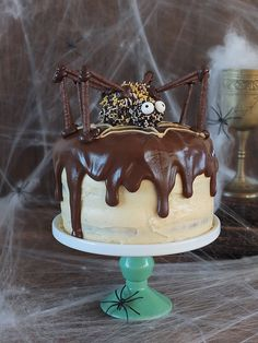 A three tier chocolate & peanut butter swirl cake with peanut butter frosting topped with a giant spider! In collaboration with SKIPPY® Peanut Butter. #ad