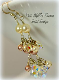 These unique earrings feature a wire-wrapped chain of 6mm Swarovski pearls complete with a Swarovski teardrop crystal pendant. 4mm pearls and crystals dangle delicately from each section. The wire-wrapped chain is made from sterling silver wire and links to sterling silver french earwires. You may choose one or two pearl colors from our large selection. $24.00