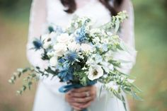 Blue bridal bouquet. Photo by Lukas Chan Photo Lab. www.theweddingnotebook.com