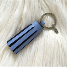 Coach Brand new tassel -genuine leather! Genuine leather tassel. Never used, but has some super tiny marks on metal from sitting in a drawer. Beautiful periwinkle blue color. Make an offer! Coach Accessories