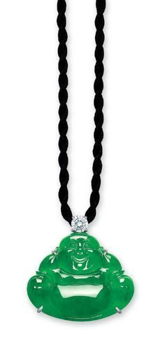 A carved jadeite Buddha and diamond pendant necklace.