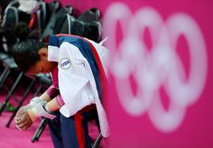 Gabrielle Douglas waits before competing in the uneven bars event during the artistic gymnastics women's individual all-around competition at the 2012 Summer Olympics, on Aug. 2, 2012, in London. Photo (c) Mike Blake/Reuters via Time Magazine