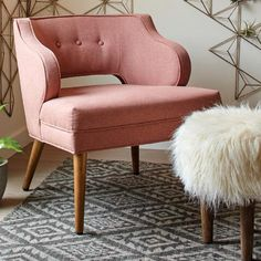 Featuring a plush, ivory-toned faux fur top inspired by the flokati wool shag rugs of Greece, our fun and modern hardwood footstool is ideal in front of an accent chair or at the foot of a bed.