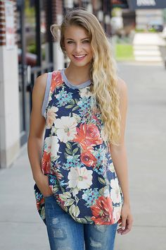 Rustic blooms! This racer back floral tank has a longer, loose fit that not only makes it comfy but perfect for denim or leggings! Style with your favorite cardigans