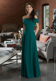 Shop Morilee's Chiffon Bridesmaid Dress Featuring a Classic Off the Shoulder Neckline.  Timeless Chiffon Bridesmaid Dress Featuring a Classic Off-the-Shoulder Neckline. View the Chiffon Swatch Card for Color Options. Shown in Emerald.