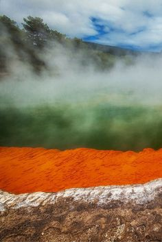 Standing on the edge of the Thermal Pools of Rotorua, New Zealand - Reasons to visit New Zealand < Do you really need any? | The Planet D: Adventure Travel Blog