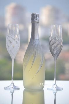 Item details: Pair of champagne flutes, hand decorated with an original design. Dimensions: h=265mm d=75mm Capacity: 190ml. Personalization: Names and date may be hand engraved or painted to customize the flutes to your occasion. Please be aware that once the glasses are personalized,