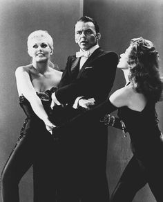 "Frank Sinatra, Kim Novak, and Rita Hayworth rehearse for the ""What Do I Care for a Dame?"" number in Pal Joey (1957)."