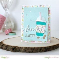 Good Morning SugarPeeps! We are so thrilled to be taking part in the SpringCoffee Lovers Blog Hop as both a participant and a sponsor! Everyone is invited to play along by creating a Spring themed coffee/cocoa card or project. All of the details for the hop, prizes and how you can join in the fun can be foundHERE. Here's a look at my caffeine crazed creation.  I started with a white cardstock base and then created layers with an Echo Park Spring paper pad andSugarCuts -Zig Zag…