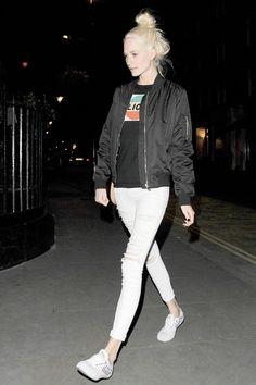 Poppy Delevingne in shredded white denim, tee, bomber jacket, and kicks.