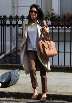 Like a model: George Clooney's fiancee Amal Alamuddin continues to showcase her seriously stylish wardrobe as she returns to work as a human rights lawyer