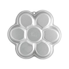 Wilton Dancing Daisy Cake Pan -- Check out the image by visiting the link.Note:It is affiliate link to Amazon.