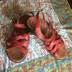 Red leather chacos Gorgeous red leather Chacos made in Portugal. These shoes are meant for an active life yet provide incredible comfort. Only flaw is a scratch on insole as pictured. Grab these for all your summer adventures!!! Chacos Shoes Sandals