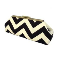 """Add a chic pop of color to your getaway ensemble with this stylish clutch, perfect for nights out on the town or dressing up your daytime look.     Product: ClutchConstruction Material: Polyester and faux silkColor: Chocolate    Features: Beautifully handmade in USA with high quality materialsFaux silk contrast liningPerfect for holding  phone, cash, or makeup Dimensions: 5"""" H x 10"""" W x 2.5"""" D"""