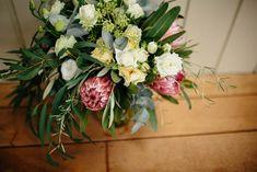 Love stomp Bridal bouquet , protea Roses foliage david auston Roses, New Zealand Weddings