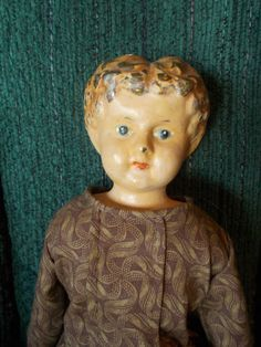 Antique Minerva tin head doll with replaced leather body, old hands 13""