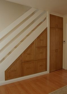 Under stairs, combo of drawers and closet
