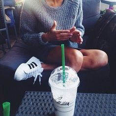Image via We Heart It #adidas #classy #girl #goals #hands #hipster #legs #Originals #shoes #sit #smile #sofa #starbucks #summer #sweater #table #tan #tumblr #weheartit #weheartit #summersweater #superstar.