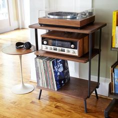 1 walnut and steel shelving unit for LP player, power and Vinyl. Dims: top: 26x17x33 middle: 23x16x22 lower: 23x16x7 For shipping purposes