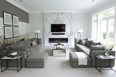Family Room designed by Enviable Designs - A refined and sophisticated design concept with a cool and light feel so our aesthetic reflected just that.  Using a monochromatic color palette of whites, greys and champagne tones, we created a formal and timeless house that matched the grand and classically inspired architecture.